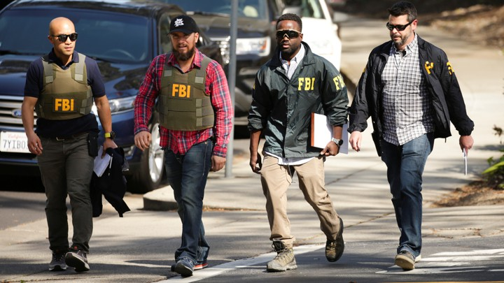 FBI agents are seen near Youtube headquarters following an active shooter situation in San Bruno, California, U.S., April 3, 2018. REUTERS/Elijah Nouvelage - RC1116371780
